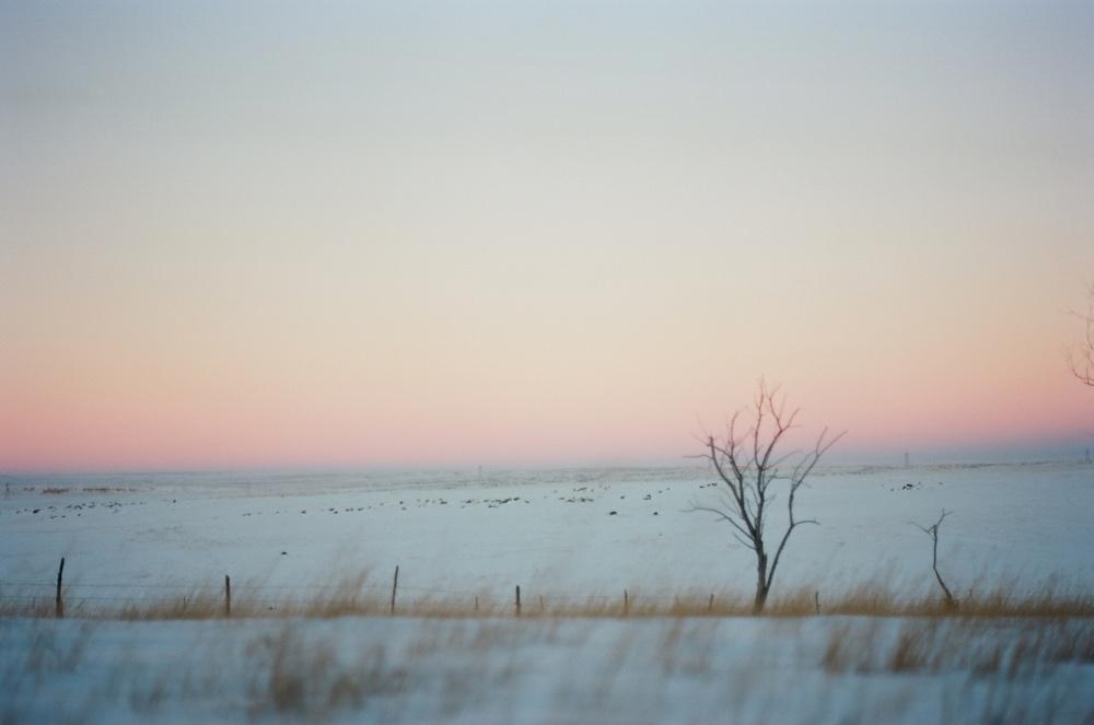 spring snow wyoming prairie sunset